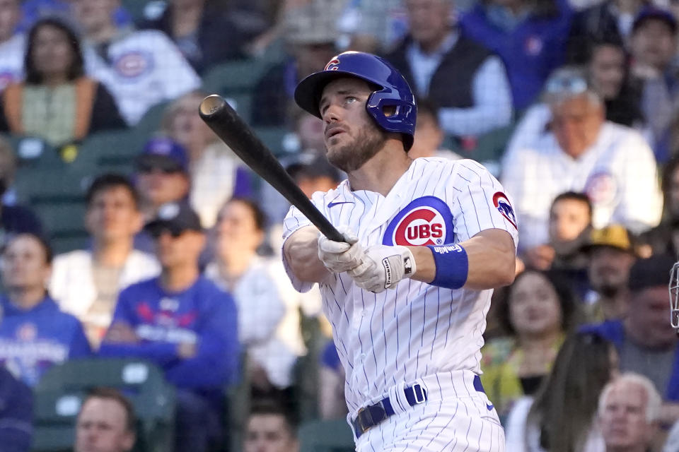 Chicago Cubs' Patrick Wisdom watches his two-run home run off San Diego Padres starting pitcher Ryan Weathers in the second inning of a baseball game Tuesday, June 1, 2021, in Chicago. (AP Photo/Charles Rex Arbogast)