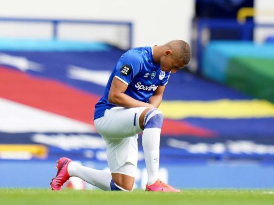 Richarlison takes a knee in support of the Black Lives Matter movement (2020 Pool)