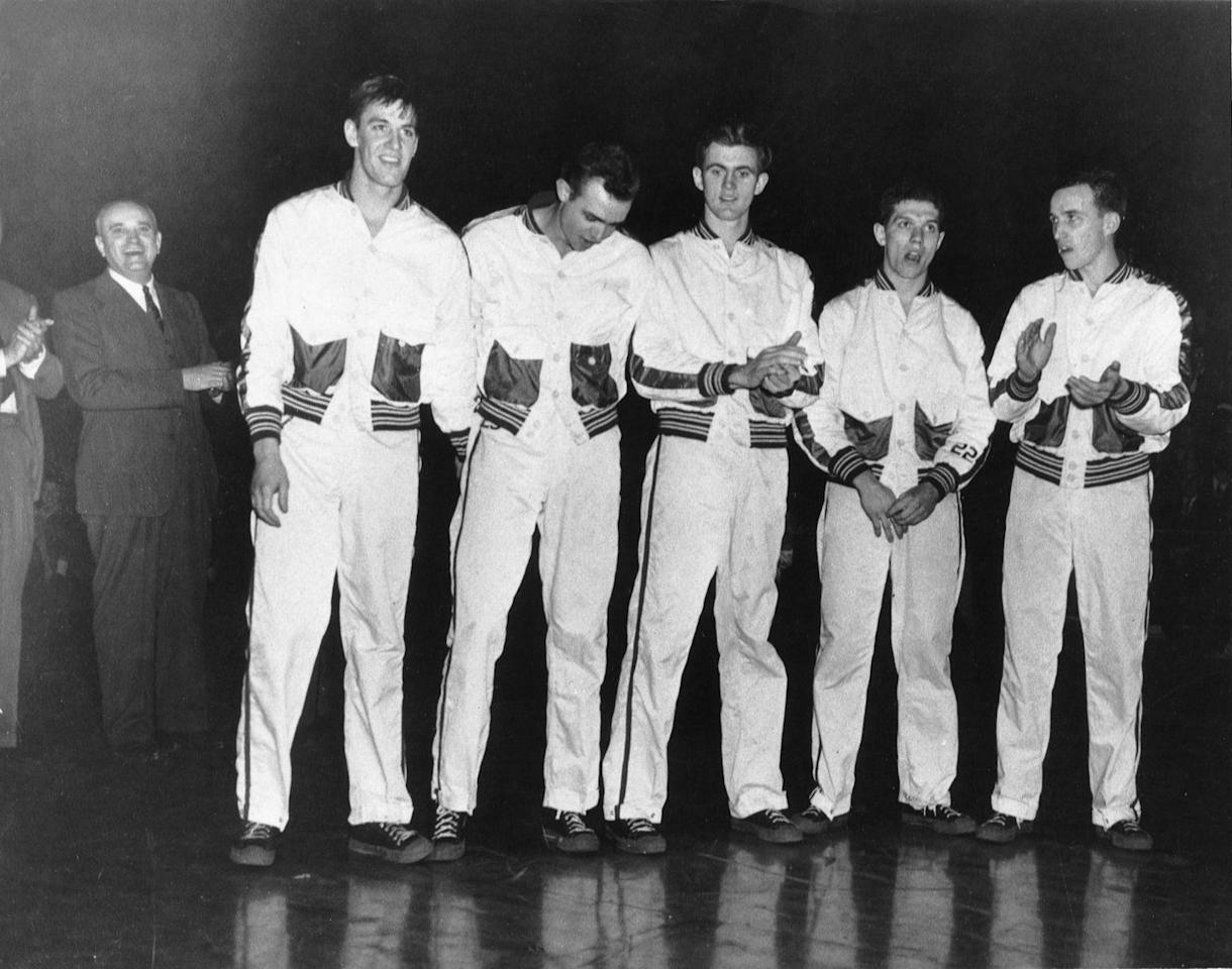 <p>The University of Kentucky players line up before the Final Four game in 1948. The tournament is single elimination format and, at the time of its origination, only included eight teams. </p>