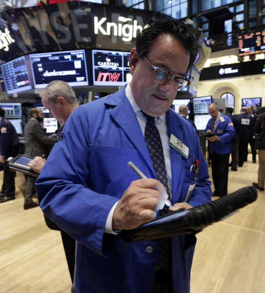Trader Peter Costa, center, works on the floor of the New York Stock Exchange Monday, Feb. 25, 2013. Stocks are opening higher on Wall Street, following the first weekly decline in the S&P 500 index this year. (AP Photo/Richard Drew)