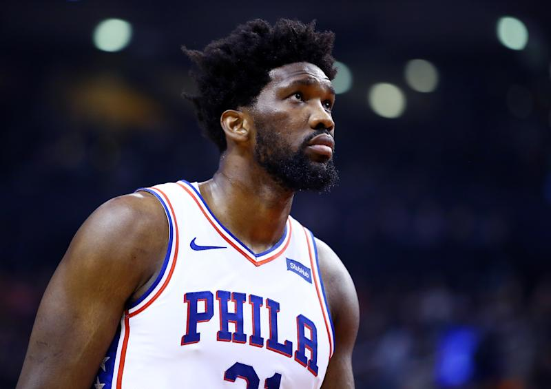 TORONTO, ON - NOVEMBER 25: Joel Embiid #21 of the Philadelphia 76ers looks on during the first half against the Toronto Raptors at Scotiabank Arena on November 25, 2019 in Toronto, Canada. NOTE TO USER: User expressly acknowledges and agrees that, by downloading and or using this photograph, User is consenting to the terms and conditions of the Getty Images License Agreement. (Photo by Vaughn Ridley/Getty Images)