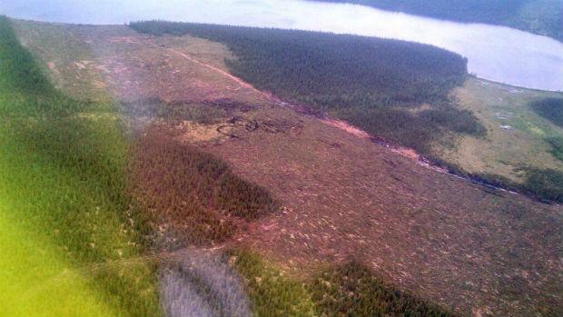 An aerial shot taken Saturday of the fire break between the fire and the town of Wabush.
