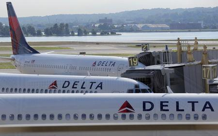FILE PHOTO: Delta Airlines planes are parked at gates at Ronald Reagan Washington National Airport in Washington