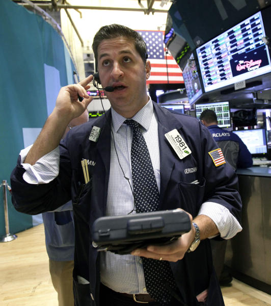Trader Thomas Donato works on the floor of the New York Stock Exchange Monday, Oct. 22, 2012. A weak forecast from heavy equipment maker Caterpillar and other poor earnings results weighed on the U.S. stock market in early trading. (AP Photo/Richard Drew)