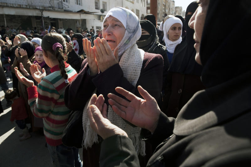 A woman weeps as she prays during an anti-government demonstration in Idlib, north Syria, Friday, March 9, 2012. (AP Photo/Rodrigo Abd)