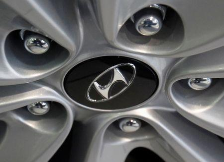 FILE PHOTO -  The logo of Hyundai Motor is seen on a wheel of a car at a Hyundai dealership in Seoul