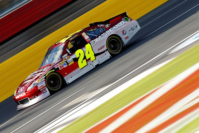 CHARLOTTE, NC - OCTOBER 13: Jeff Gordon drives the #24 Drive to End Hunger/Chevy 100th Anniversay Chevrolet during practice for the NASCAR Sprint Cup Series Bank of America 500 at Charlotte Motor Speedway on October 13, 2011 in Charlotte, North Carolina. (Photo by Geoff Burke/Getty Images for NASCAR)