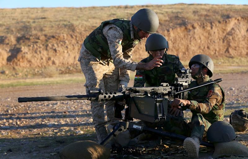 Kurdish Peshmerga fighters train with British military advisers (unseen) at a shooting range on the outskirts of Arbil, on November 5, 2014