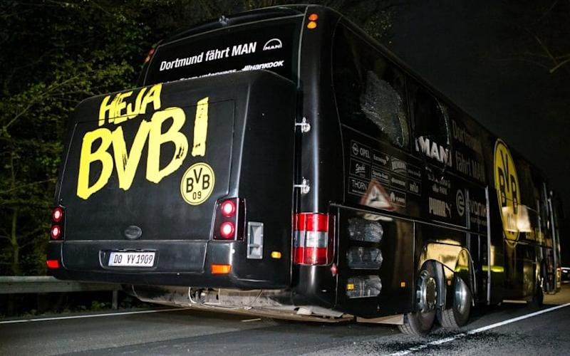 The Borussia Dortmund bus after the explosions - Credit: Maja Hitij/Getty