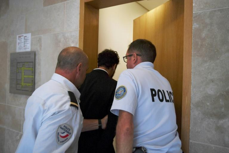 Moroccan singer Saad Lamjarred (C) is escorted by police officers at a courthouse in France's Aix-en-Provence on September 18, 2018