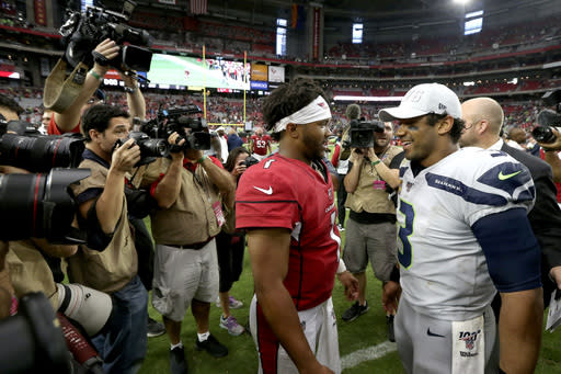Seattle Seahawks quarterback Russell Wilson (3), right, and Arizona Cardinals quarterback Kyler Murray (1) meet after an NFL football game, Sunday, Sept. 29, 2019, in Glendale, Ariz. The Seahawks won 27-10. (AP Photo/Ross D. Franklin)