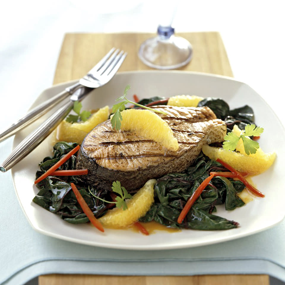 "<p>A splash of toasted sesame oil adds a delicious, nutty nuance to the orange dressing. <a href=""http://www.eatingwell.com/recipe/264577/salmon-with-wilted-greens/"" rel=""nofollow noopener"" target=""_blank"" data-ylk=""slk:View recipe"" class=""link rapid-noclick-resp""> View recipe </a></p>"