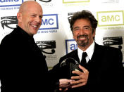 """Actor Bruce Willis (L) presents actor Al Pacino with the 20th annual """"American Cinematheque Award"""" in Beverly Hills October 21, 2005. Pacino is this year's award recipient for his significant contribution to the art of the moving picture. The benefit event will broadcast on AMC on January 22, 2006. REUTERS/Mario Anzuoni"""