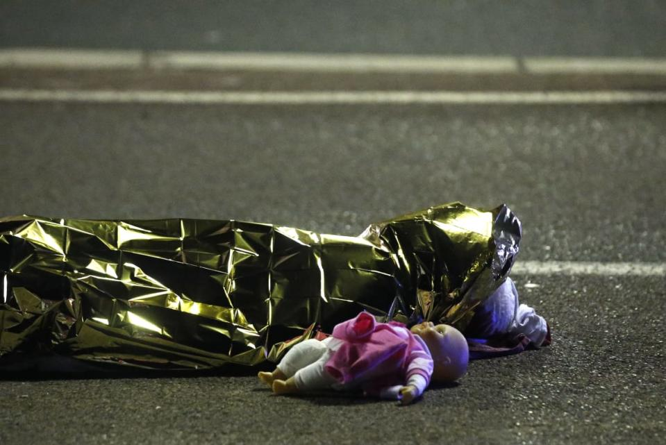 "<div class=""inline-image__caption""><p>A body is seen on the ground July 15, 2016 after at least 30 people were killed in Nice, France, when a truck ran into a crowd celebrating the Bastille Day national holiday July 14.</p></div> <div class=""inline-image__credit"">Eric Gaillard/Reuters</div>"