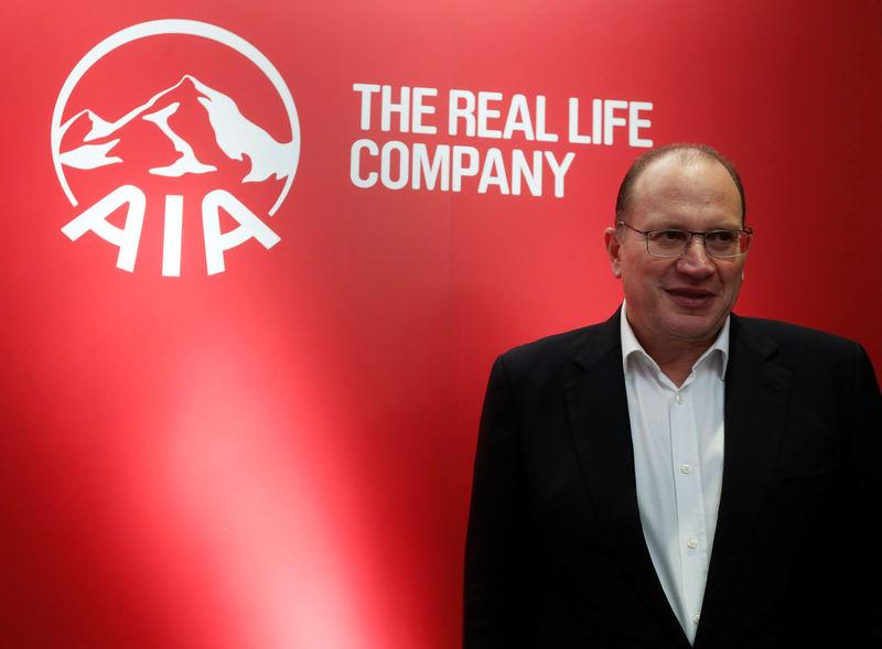 AIA Group Chief Executive and President Mark Tucker poses during a news conference in Hong Kong
