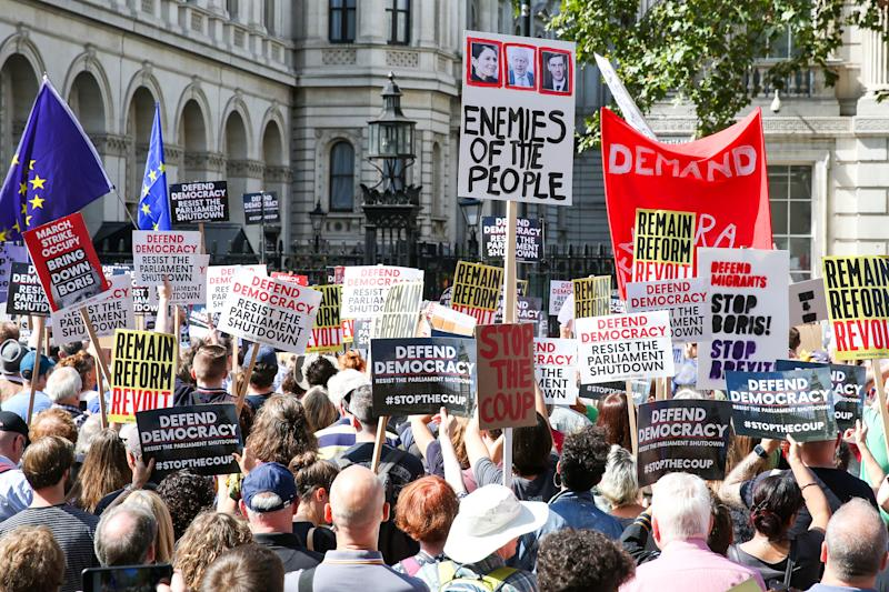 Crowd of protesters holds placards outside Downing Street in London demonstrating against British Prime Minister Boris Johnson�s plans to suspend UK parliament for five weeks ahead of a Queens Speech on 14 October, just two weeks before the UK is set to leave the EU. The Queen has approved Boris Johnson's request to prorogue UK Parliament after the Prime Minister stepped up his plans for a no deal Brexit. (Photo by Steve Taylor / SOPA Images/Sipa USA)