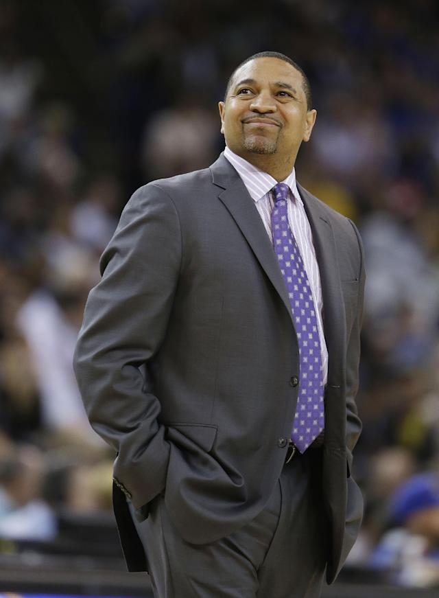 Golden State Warriors coach Mark Jackson looks up at the scoreboard after calling a time out during the first quarter of the Warriors' NBA basketball game against the San Antonio Spurs Saturday, March 22, 2014, in Oakland, Calif. (AP Photo/Eric Risberg)