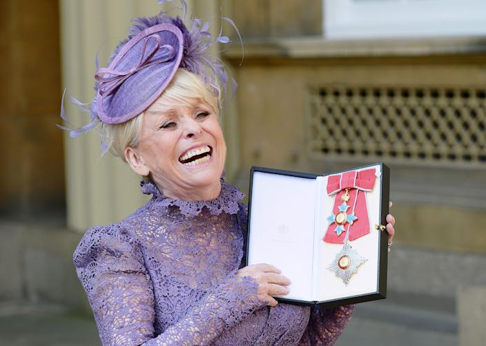 Television star Barbara Windsor after she was made a Dame Commander of the order of the British Empire by Queen Elizabeth II for her services to charity and entertainment during an Investiture ceremony at Buckingham Palace on March 22, 2016 in London, England. (John Stillwell - WPA Pool / Getty Images)