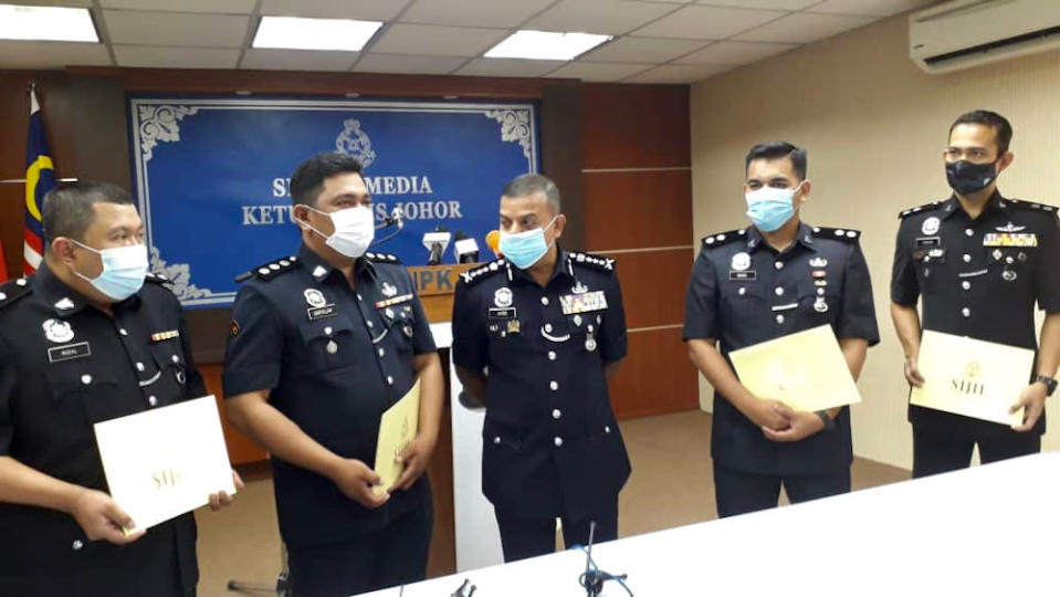 Johor police chief Datuk Ayob Khan Mydin Pitchay (centre) after giving out integrity commendation letters to police officers at the Johor police contingent headquarters in Johor Baru December 3, 2020. — Picture by Ben Tan