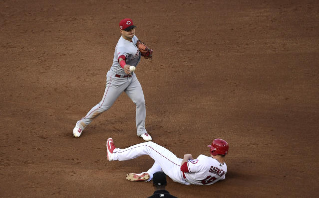 Los Angeles Angels' Dustin Garneau, right, is forced out at second as Cincinnati Reds shortstop Jose Iglesias throws out Tommy La Stella at first during the fifth inning of a baseball game Wednesday, June 26, 2019, in Anaheim, Calif. (AP Photo/Mark J. Terrill)