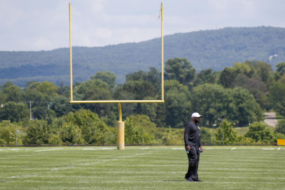 Pittsburgh Steelers head coach Mike Tomlin walks in front of a goal post on one of the practice fields on the first day of drills at their NFL football training camp practice in Latrobe, Pa., Friday, July 26, 2019. (AP Photo/Keith Srakocic)
