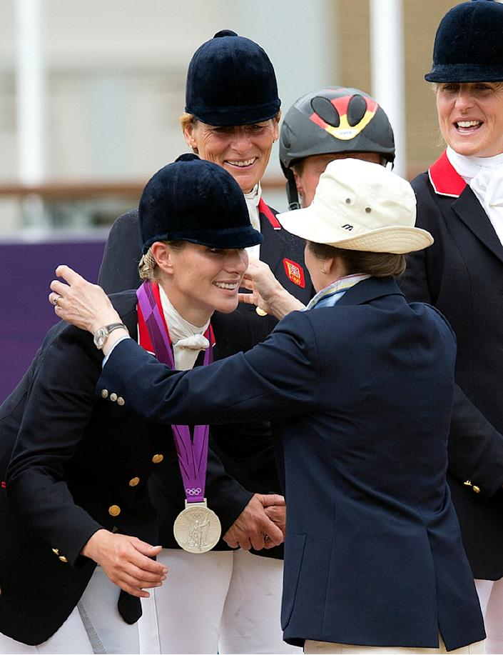 Princess Anne presents her daughter Zara with a silver medal (AFP via Getty Images)