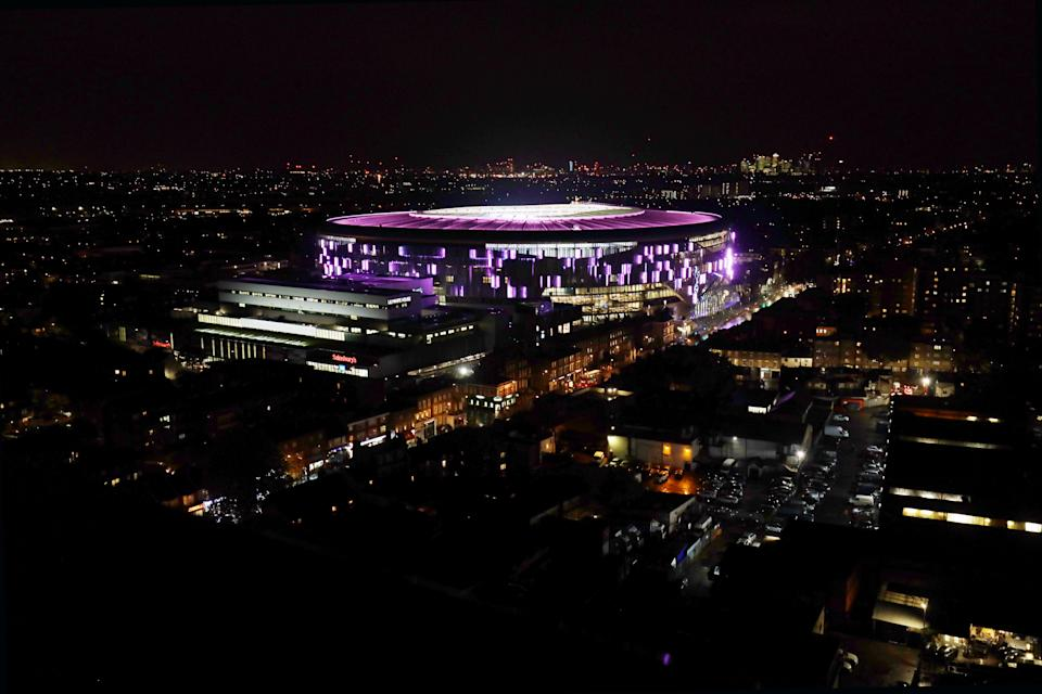 """ENFIELD, ENGLAND - OCTOBER 17: Tottenham Hotspur stadium is lit up pink to support Breast Cancer Now's, """"Wear it Pink"""" day at Tottenham Hotspur Stadium on October 17, 2019 in Enfield, England. (Photo by Tottenham Hotspur FC/Tottenham Hotspur FC via Getty Images)"""
