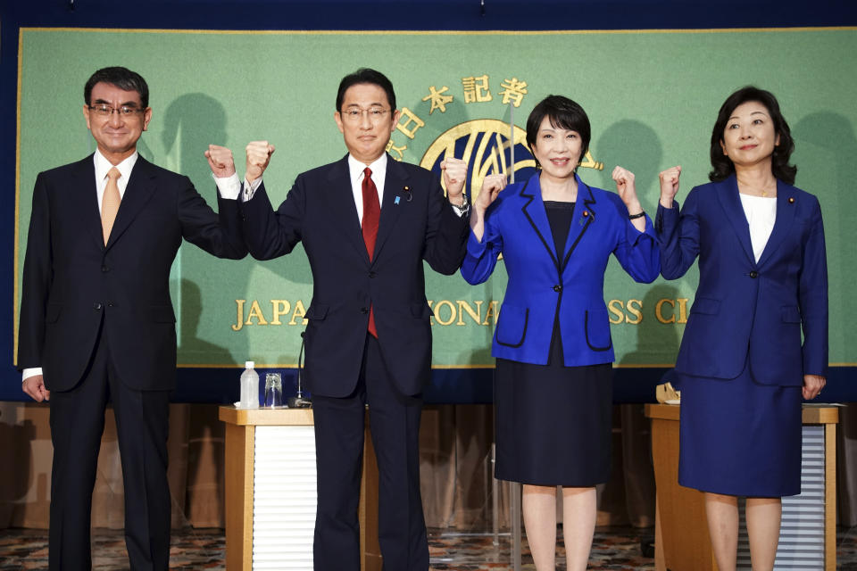 FILE - In this Sept. 18, 2021, file photo, Candidates for the presidential election of the ruling Liberal Democratic Party pose for photographers prior to a debate session held by Japan National Press club in Tokyo. The contenders are, from left to right, Taro Kono, the cabinet minister in charge of vaccinations, Fumio Kishida, former foreign minister, Sanae Takaichi, former internal affairs minister, and Seiko Noda, former internal affairs minister. The inclusion of two women among the four candidates vying to become the next prime minister seems like a big step forward for Japan's notoriously sexist politics. (AP Photo/Eugene Hoshiko, File)