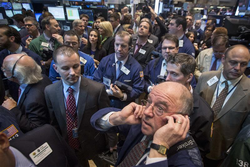 Traders wait for Q2 Holdings, Inc. to begin trading during their IPO on the floor of the New York Stock Exchange