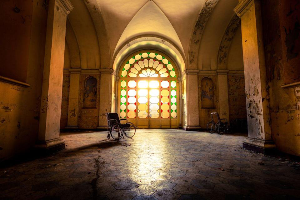 <p>Golden rays from the afternoon sun fill this empty hospital hall with a soft, warm glow.</p>