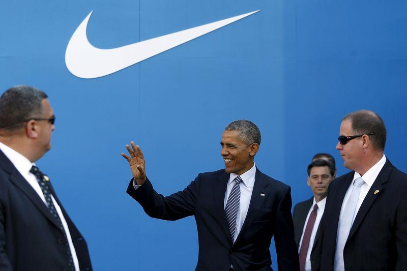 U.S. President Obama waves as he arrives to deliver remarks on trade at Nike's corporate headquarters in Beaverton, Oregon