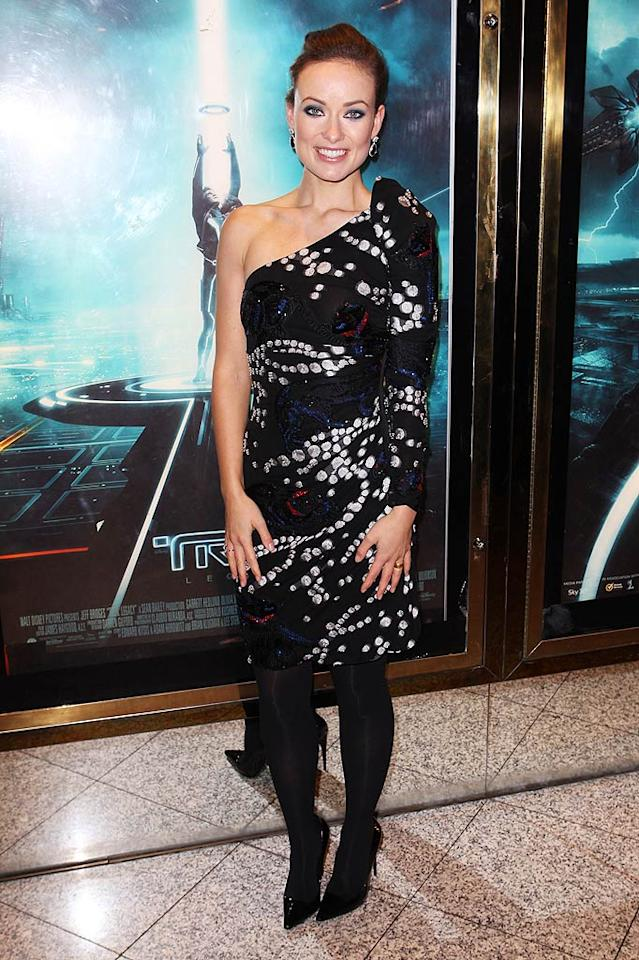 """Across the pond at the London premiere of """"Tron: Legacy,"""" Olivia Wilde turned heads in a multi-colored Giorgio Armani dress, black Stella McCartney pumps, and jewels courtesy of Tiffany. Dave Hogan/Mission Pictures/<a href=""""http://www.gettyimages.com/"""" target=""""new"""">GettyImages.com</a> - December 5, 2010"""