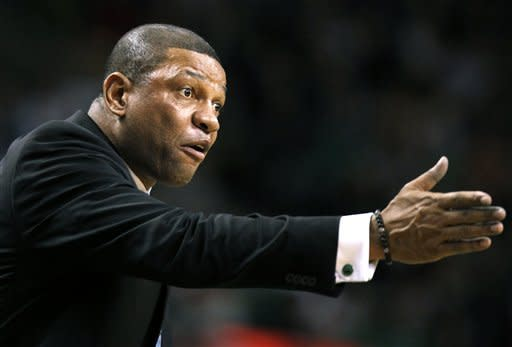 Boston Celtics coach Doc Rivers reacts to a call in the fourth quarter of an NBA basketball game against the Cleveland Cavaliers in Boston, Sunday, Jan. 29, 2012. The Cavaliers won 88-87. (AP Photo/Michael Dwyer)