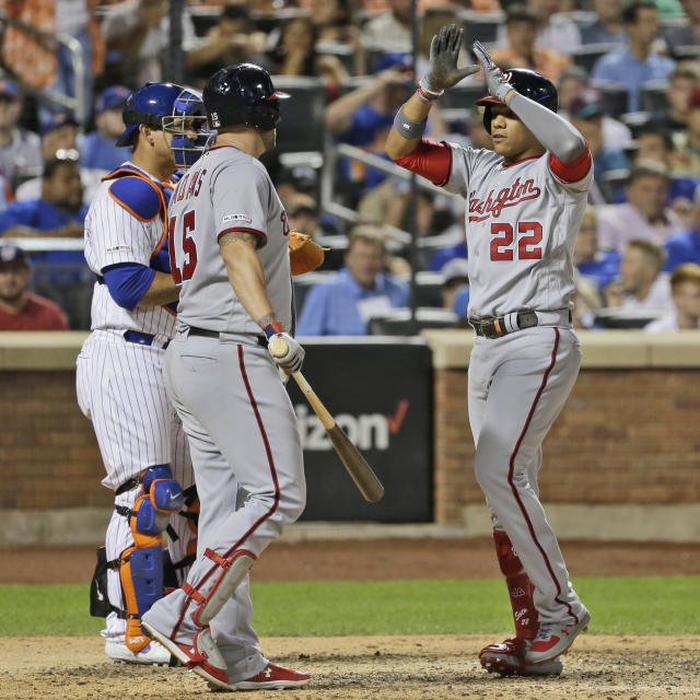 Washington Nationals' Juan Soto, right, celebrates his home run with Matt Adams during the eighth inning of a baseball game against the New York Mets, Saturday, Aug. 10, 2019, in New York. (AP Photo/Seth Wenig)