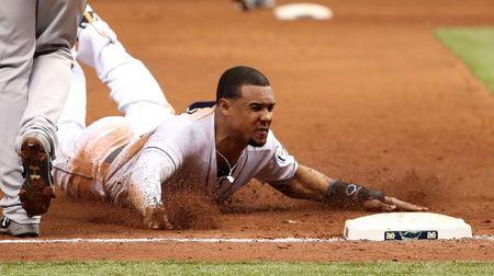 Jun 22, 2018; St. Petersburg, FL, USA; Tampa Bay Rays right fielder Carlos Gomez (27) slides safe into third base during the sixth inning against the New York Yankees at Tropicana Field. Mandatory Credit: Kim Klement-USA TODAY Sports