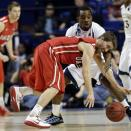 Davidson guard Nik Cochran, front, and Marquette guard Derrick Wilson collide during the second half of their second-round NCAA college basketball tournament game, Thursday, March 21, 2013, in Lexington, Ky. Marquette won 59-58. (AP Photo/John Bazemore)