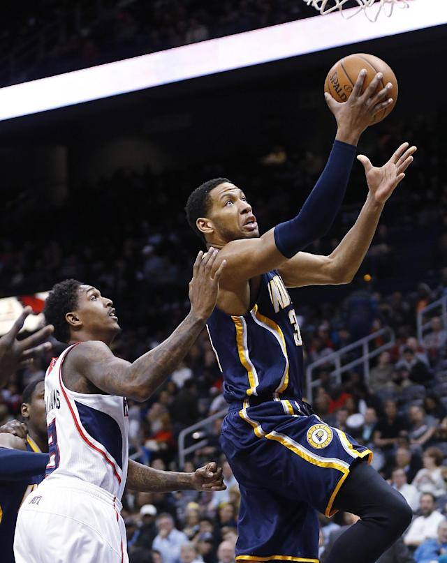 Indiana Pacers small forward Danny Granger (33) drives to the basket as Atlanta Hawks shooting guard Louis Williams (3) defends in the first half of an NBA basketball game, Tuesday, Feb. 4, 2014, in Atlanta (AP Photo/John Bazemore)