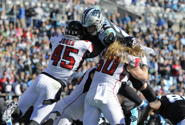 Carolina Panthers' Christian McCaffrey (22) is hit by Atlanta Falcons' Deion Jones (45) during the first half of an NFL football game in Charlotte, N.C., Sunday, Dec. 23, 2018. (AP Photo/Mike McCarn)