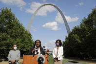 FILE - In this Aug. 5, 2020, file photo, activist Cori Bush, center, speaks as St. Louis Treasurer Tishaura Jones, right, and Circuit Attorney Kim Gardner, left, listen, during a news conference in St. Louis. Bush pulled a political upset on Tuesday, beating 20-year incumbent Rep. William Lacy Clay in Missouri's 1st District Democratic primary. Bush, who led protests after the fatal police shooting of Michael Brown in Ferguson, ousted longtime Rep. William Lacy Clay in Missouri's Democratic primary, ending a political dynasty that had spanned more than a half-century. Bush said among her first priorities is a more robust COVID-19 relief package that provides greater assistance to families. (AP Photo/Jeff Roberson, File)
