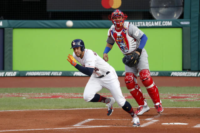 American League's George Springer, of the Houston Astros, singles during the first inning of the MLB baseball All-Star Game against the National League, Tuesday, July 9, 2019, in Cleveland. (AP Photo/Ron Schwane)