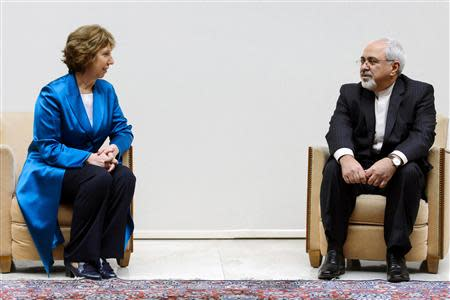 EU foreign policy chief Ashton speaks with Iranian Foreign Minister Zarif during a photo opportunity in Geneva