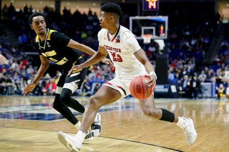 Mar 22, 2019; Tulsa, OK, USA; Texas Tech Red Raiders guard Jarrett Culver (23) controls the ball as Northern Kentucky Norse guard Jalen Tate (11) defends during the second half in the first round of the 2019 NCAA Tournament at BOK Center. Mandatory Credit: Brett Rojo-USA TODAY Sports