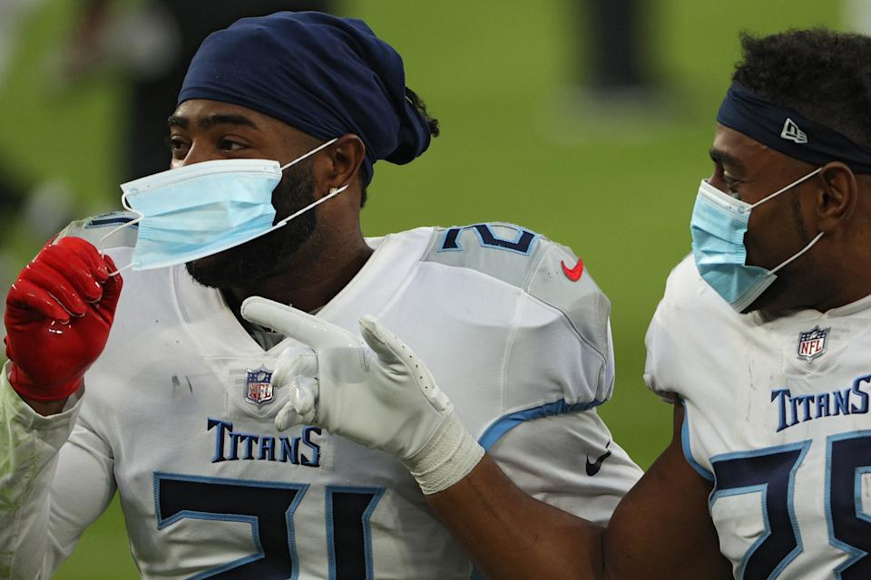 Two members of the Tennessee Titans celebrate after defeating the Baltimore Ravens on November 22, 2020. The team experienced a major outbreak in October that led the NFL to escalate precautions. (Photo by Patrick Smith/Getty Images)