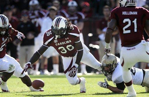 South Carolina safety D.J. Swearinger (36) recovers a fumble during the first half of an NCAA college football game against Wofford, Saturday, Nov. 17, 2012, in Columbia, S.C. (AP Photo/Stephen Morton)