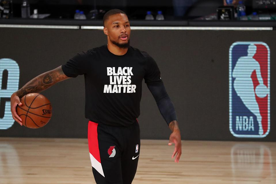 LAKE BUENA VISTA, FLORIDA - AUGUST 20:  Damian Lillard #0 of the Portland Trail Blazers warms up before action against the Los Angeles Lakers in game two of the first round of the NBA playoffs at AdventHealth Arena at ESPN Wide World Of Sports Complex on August 20, 2020 in Lake Buena Vista, Florida. NOTE TO USER: User expressly acknowledges and agrees that, by downloading and or using this photograph, User is consenting to the terms and conditions of the Getty Images License Agreement. (Photo by Kim Klement-Pool/Getty Images)