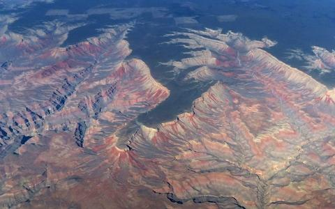 An aerial view of the Grand Canyon in Arizona - Credit: RHONA WISE /AFP