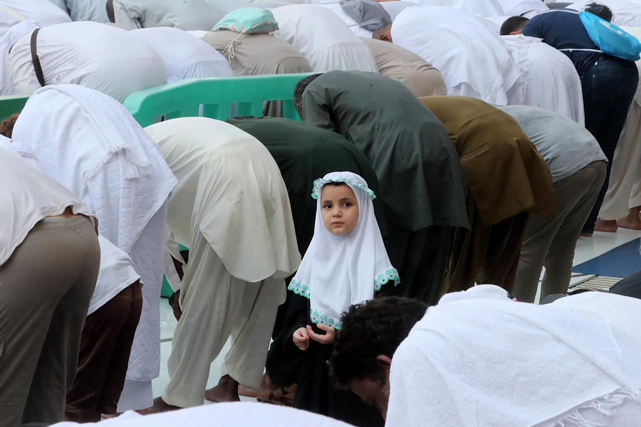 A young girl looks on as Muslim pilgrims pray at the Grand Mosque in the holy Saudi city of Mecca, on Aug. 29, 2017, on the eve of the start of the annual hajj pilgrimage. (Photo: Karim Sahib/AFP/Getty Images)