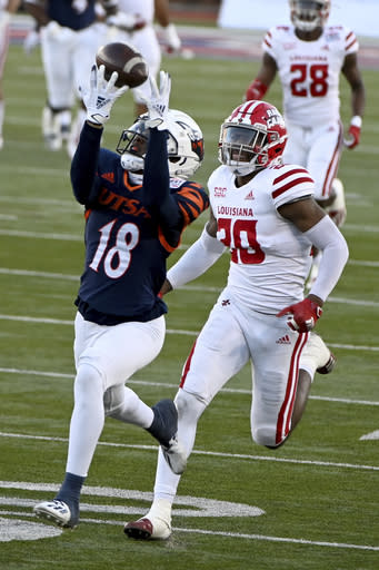 UTSA wide receiver Zakhari Franklin (18) catches a pass in front of Louisiana cornerback Mekhi Garner (20) in the third quarter during the SERVPRO First Responders Bowl NCAA college football game in Dallas, Saturday, Dec. 26, 2020. (AP Photo/Matt Strasen)