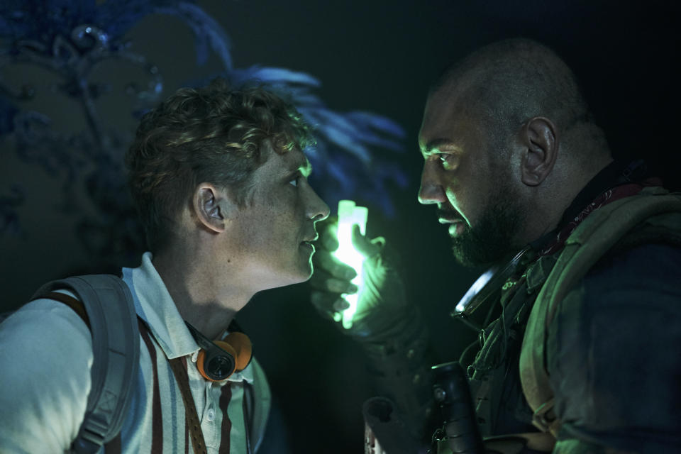 """This image released by Netflix shows Matthias Schweighofer, left, and Dave Bautista in a scene from """"Army of the Dead."""" (Clay Enos/Netflix via AP)"""