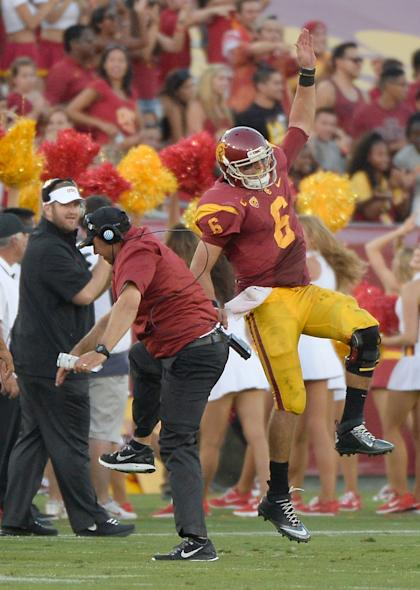 USC QB Cody Kessler chest-bumps with coach Steve Sarkisian. (Getty Images)